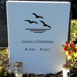picture of installed peaceyard gravestone, model ada in glacier white color with standard base and round planter