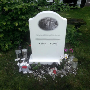 picture of installed peaceyard gravestone, model cora in glacier white color with standard base
