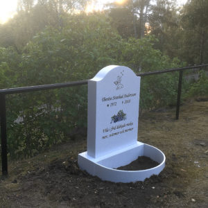 picture of installed peaceyard gravestone, model cora in everest color with standard base and round planter