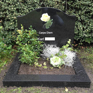 picture of installed peaceyard gravestone, custom model cora in deep night sky color with standard base and square planter