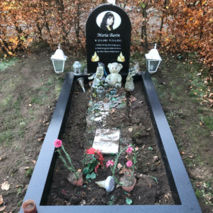 picture of installed peaceyard gravestone, model eliza in deep night sky color with standard base and full wide frame