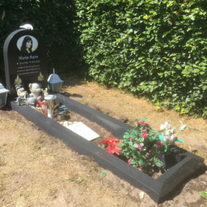 picture of installed peaceyard gravestone, model eliza in deep night sky color with standard base and full frame