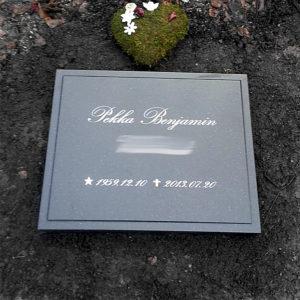 picture of installed peaceyard horizontal gravestone, model ida in deep night sky color