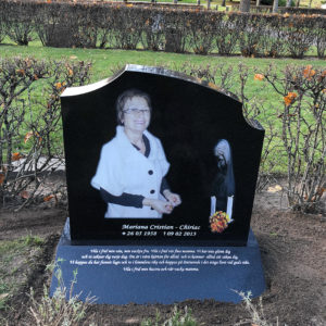 front picture of installed peaceyard gravestone, model meral in deep night sky color with sloped base
