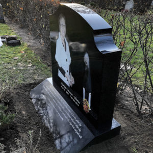 side picture of installed peaceyard gravestone, model meral in deep night sky color with sloped base