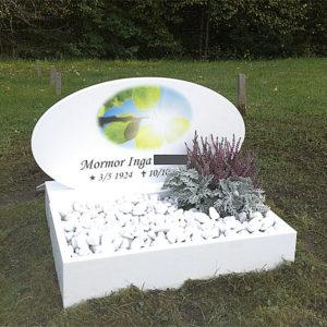 picture of installed peaceyard gravestone, model viola in glacier white color and custom square planter