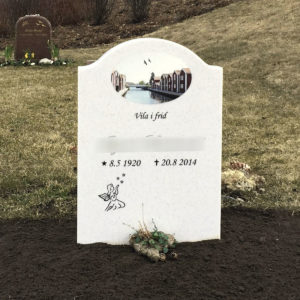 picture of installed peaceyard upright gravestone, model cora in everest material with customer graphics
