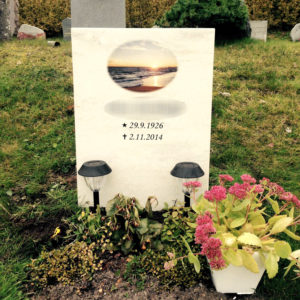 picture of installed peaceyard upright gravestone, model ada in clam shell material with customer graphics