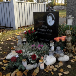 picture of installed peaceyard upright gravestone, model ada in night sky material with customer graphics
