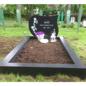 picture of installed peaceyard upright gravestone, model avalie in night sky color with customer graphics