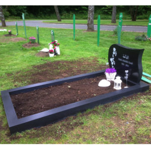 picture of installed peaceyard upright gravestone, model avalie in night sky material with customer graphics