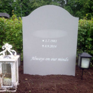 picture of installed peaceyard upright gravestone, model cora in dove material with customer graphics