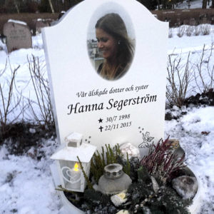 picture of installed peaceyard upright gravestone, model cora in glacier white color with customer graphics