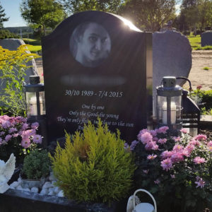 picture of installed peaceyard upright gravestone, model cora in night sky material with customer graphics