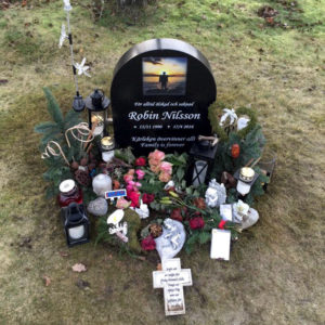 picture of installed peaceyard upright gravestone, model eliza in night sky material with customer graphics