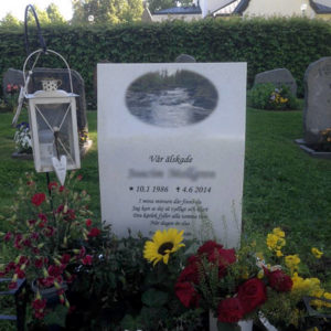 picture of installed peaceyard upright gravestone, model kitty in everest material with customer graphics