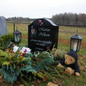 picture of installed peaceyard upright gravestone, model cora in night sky material with standard base and square planter