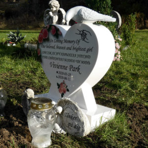 picture of installed peaceyard gravestone, model melody mini in glacier white material with standard base