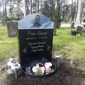 picture of installed peaceyard upright gravestone, Cora in night sky material with customer graphics