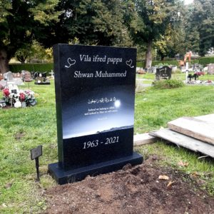 picture of installed peaceyard upright gravestone, Ada in Deep Night Sky material with customer graphics