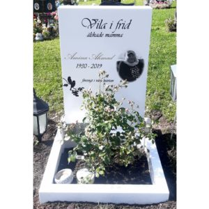 picture of installed peaceyard upright gravestone, Ada in Glacier White material with customer graphics