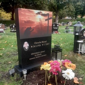 picture of installed peaceyard upright gravestone, Ada in Night Sky material with customer graphics